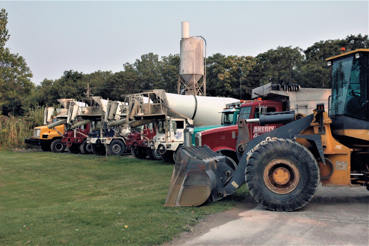 Shown:  Fleet of delivery trucks that enable Akerly Concrete, Inc. in Erie, PA to offer prompt, dependable concrete and ready mix delivery, fair pricing and quality products.